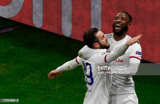 Lyon's French midfielder Lucas Tousart celebratres with Lyon's French forward Moussa Dembele after scoring a try during the UEFA Champions League...