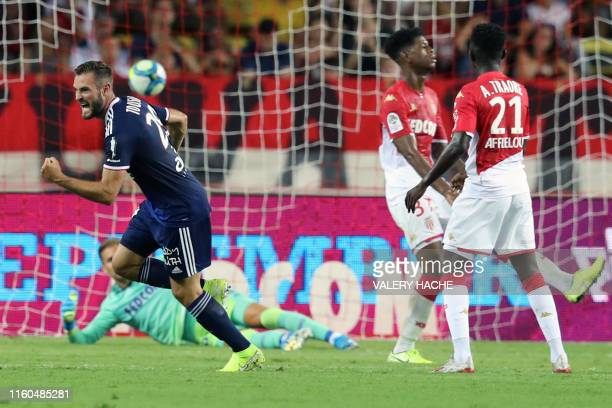 Lyon's French midfielder Lucas Tousart gestures after scoring the 0-3 goal during the French L1 football match between AS Monaco and Olympique...
