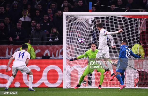 Lyon's French midfielder Lucas Tousart scores a goal during the UEFA Champions League round of 16 first-leg football match between Lyon and Juventus...