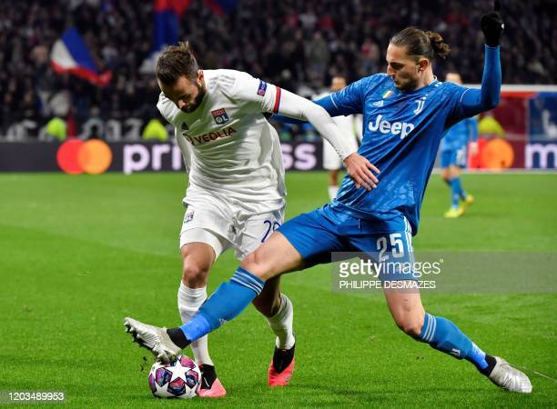 Lyon's French midfielder Lucas Tousart vies for the ball with Juventus' French midfielder Adrien Rabiot during the UEFA Champions League round of 16...
