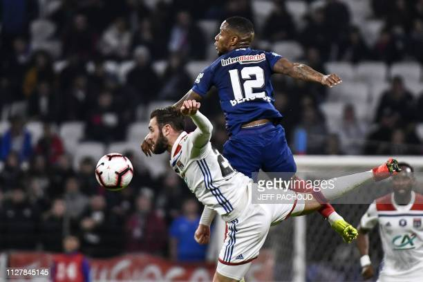 Lyon's French midfielder Lucas Tousart vies with Caen's French forward Claudio Beauvue during the French Cup quarter-final football match between...