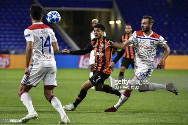 Lyon's French midfielder Lucas Tousart vies with Donetsk's Brazilian midfielder Taison during their UEFA Champions League Group F football match...