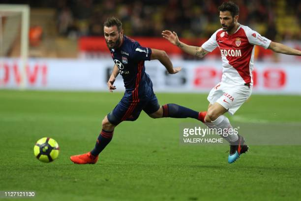 Lyon's French midfielder Lucas Tousart vies with Monaco's Spanish midfielder Cesc Fabregas during the French L1 football match Monaco vs Lyon on...