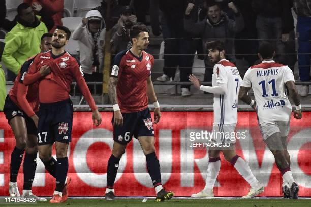 Lyon's French midfielder Martin Terrier celebrates after scoring a goal during the French L1 football match between Olympique Lyonnais and Lille on...