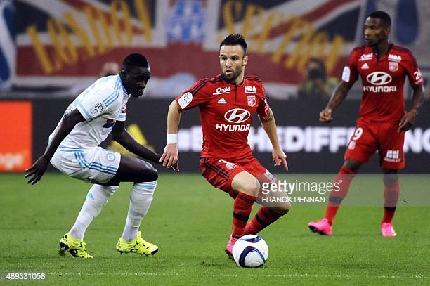 Lyon's French midfielder Mathieu Valbuena vies with Marseille's French defender Benjamin Mendy during the French L1 football match Marseille vs Lyon...