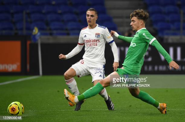 Lyon's French midfielder Maxence Caqueret fights for the ball with SaintEtienne's French midfielder Adil Aouchiche during the French L1 football...