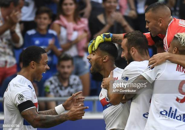 Lyon's French midfielder Nabil Fekir celebrates after scoring a goal with his teammates during the L1 football match Olympique Lyonnais vs FC...