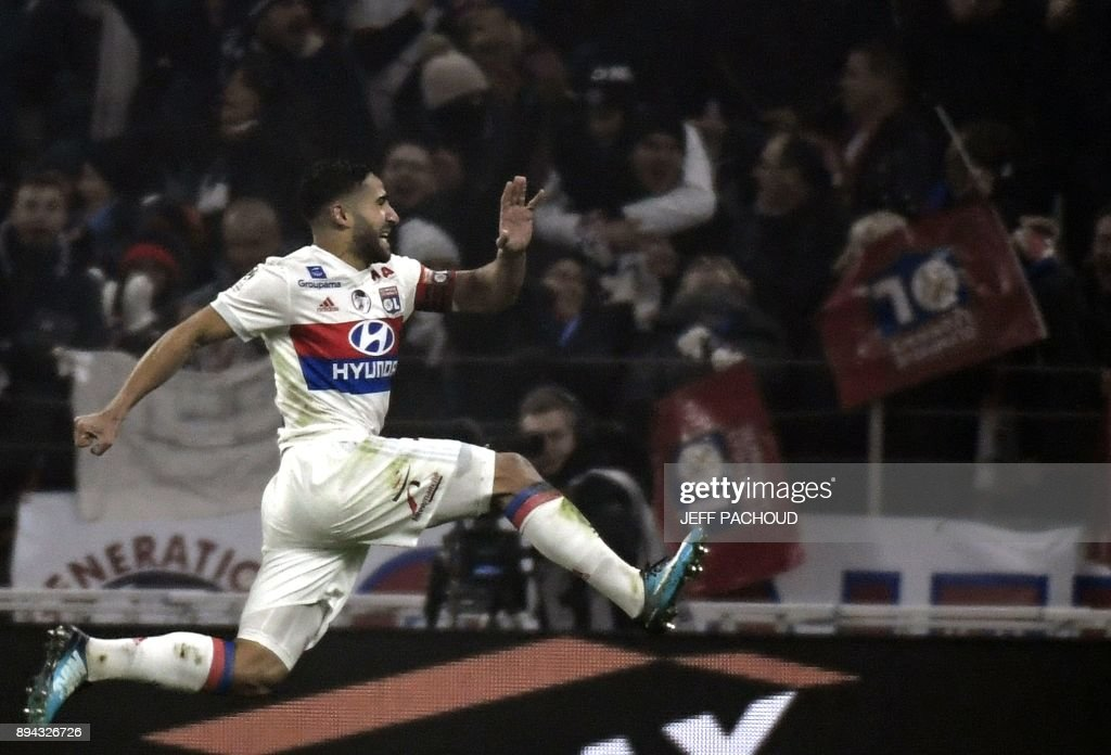 Lyon's French midfielder Nabil Fekir celebrates after scoring a goal during the French L1 football match Lyon v Marseille at The Groupama Stadium in Lyon on December 17, 2017. /