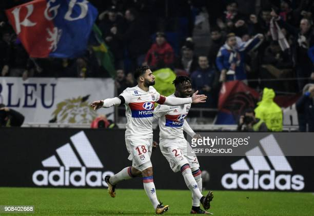 Lyon's French midfielder Nabil Fekir celebrates after scoring a goal during the French L1 football match between Olympique Lyonnais and ParisSaint...