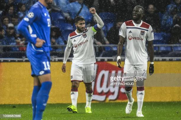 Lyon's French midfielder Nabil Fekir celebrates after scoring the opener during the UEFA Champions League Group F football match between Olympique...