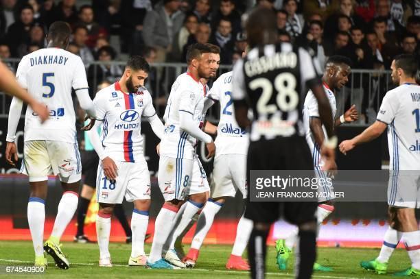 Lyon's French midfielder Nabil Fekir celebrates with teammates after scoring during the French L1 football match between Angers and Lyon at...