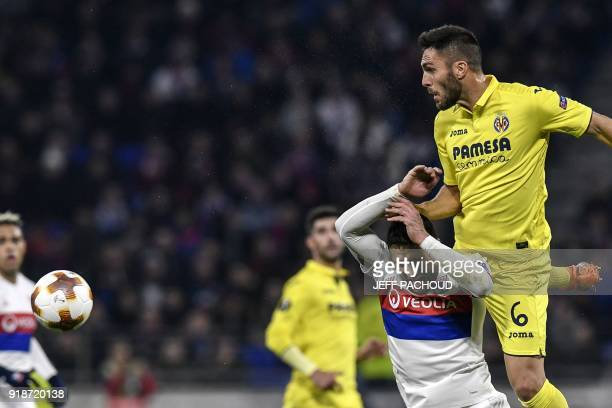 Lyon's French midfielder Nabil Fekir fights for the ball with Villarreal's Spanish defender Victor Ruiz during the Europa League football match...