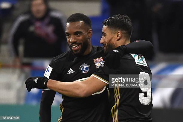 Lyon's French midfielder Nabil Fekir is congratulated by his teammate Lyon's French forward Alexandre Lacazette after scoring during the French Cup...