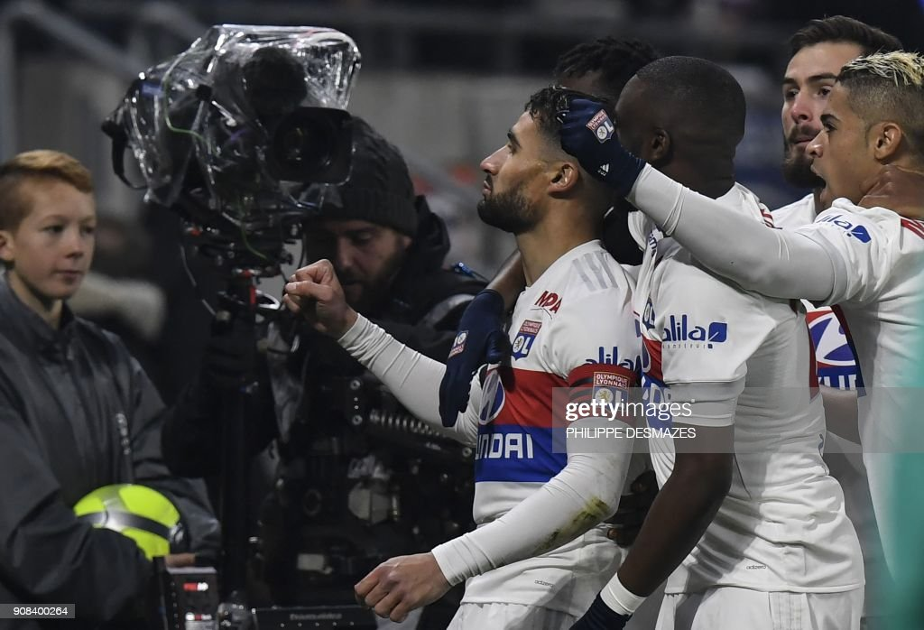 Lyon's French midfielder Nabil Fekir (C) is congratulated by teammates after scoring during the French L1 football match between Olympique Lyonnais and Paris-Saint Germain (PSG) at Groupama stadium in Decines-Charpieu on January 21, 2018. /