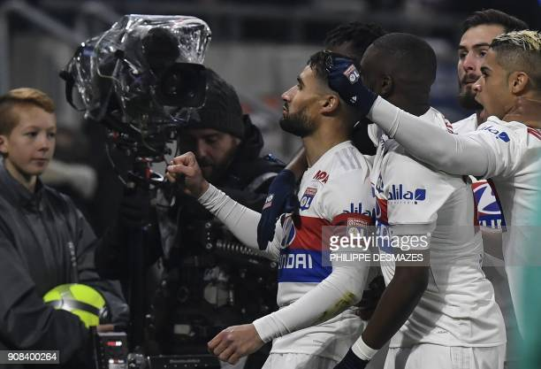 Lyon's French midfielder Nabil Fekir is congratulated by teammates after scoring during the French L1 football match between Olympique Lyonnais and...