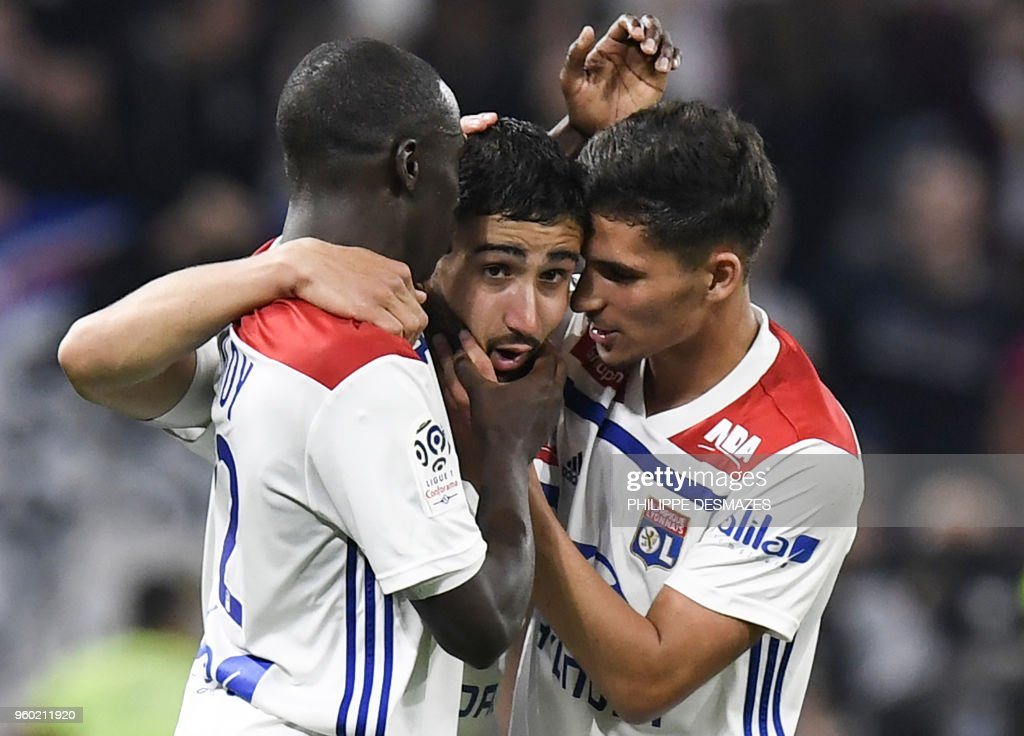 Lyon's French midfielder Nabil Fekir (C) is congratulated by teammates forward Houssem Aouar (R) and French defender Ferland Mendy (L) after scoring during the French L1 football match between Olympique Lyonnais and OGC Nice at the Groupama Stadium in Decines-Charpieu near Lyon, central-eastern France on May 19, 2018.