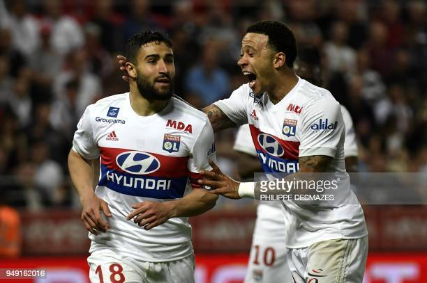 Lyon's French midfielder Nabil Fekir is congratuled by teamate Lyon's Dutch forward Memphis Depay after scoring during the French L1 football match...