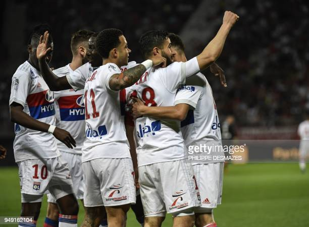 Lyon's French midfielder Nabil Fekir is congratuled by teamates after scoring during the French L1 football match between Dijon FCO and Olympique...