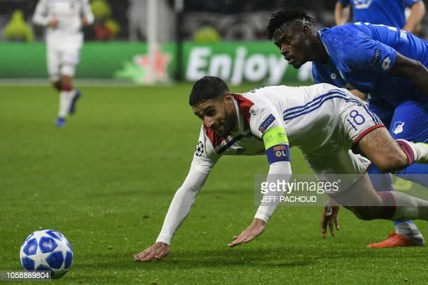 Lyon's French midfielder Nabil Fekir is tackled by Hoffenheim's Ghanaian defender Kasim Adams Nuhu during the UEFA Champions League Group F football...
