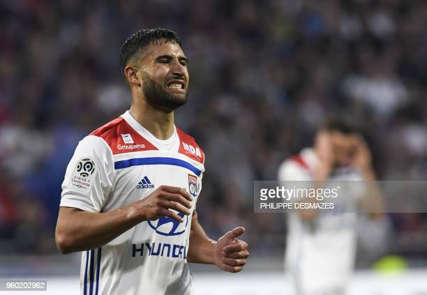 Lyon's French midfielder Nabil Fekir reacts after missing a goal during the French L1 football match between Olympique Lyonnais and OGC Nice on May...