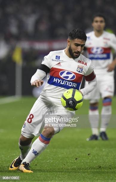 Lyon's French midfielder Nabil Fekir runs with the ball during the French L1 football match between Olympique Lyonnais and ParisSaint Germain at...