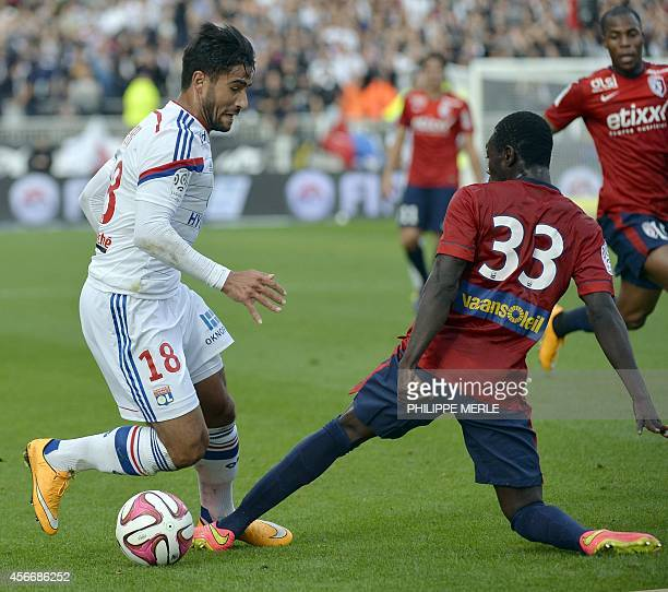 Lyon's French midfielder Nabil Fekir vies for the ball with Lille's Spanish midfielder Adama Traoré during the French L1 football match Lyon vs Lille...