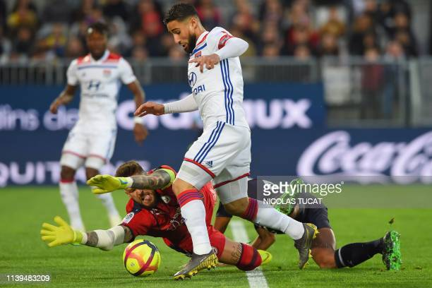 Lyon's French midfielder Nabil Fekir vies with Bordeaux's French goalkeeper Benoit Costil during the French L1 football match between Bordeaux and...