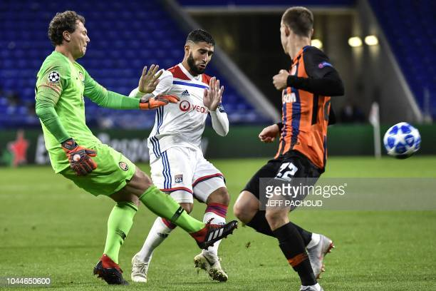 Lyon's French midfielder Nabil Fekir vies with Donetsk's Ukrainian goalkeeper Andriy Pyatov during their UEFA Champions League Group F football match...