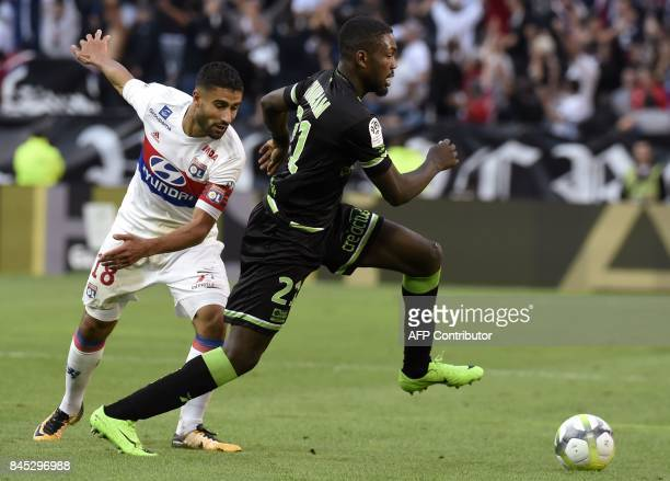 Lyon's French midfielder Nabil Fekir vies with Guingamp's French forward Marcus Thuram during the French L1 football match Lyon vs Guingamp , on...