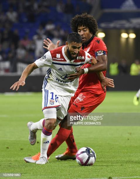 Lyon's French midfielder Nabil Fekir vies with Nice's Brazilian defender Dante during the French L1 football match between Olympique Lyonnais and OGC...
