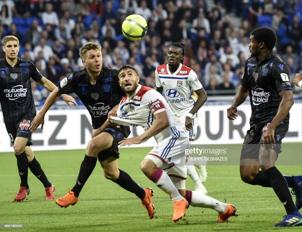Lyon's French midfielder Nabil Fekir (C) vies with Nice's French defender Arnaud Souquet (R) and Nice's Brasilian defender Santos Marlon (L) during the French L1 football match between Olympique Lyonnais and OGC Nice, on May 19, 2018, at the Groupama Stadium in Decines-Charpieu near Lyon, central-eastern France.