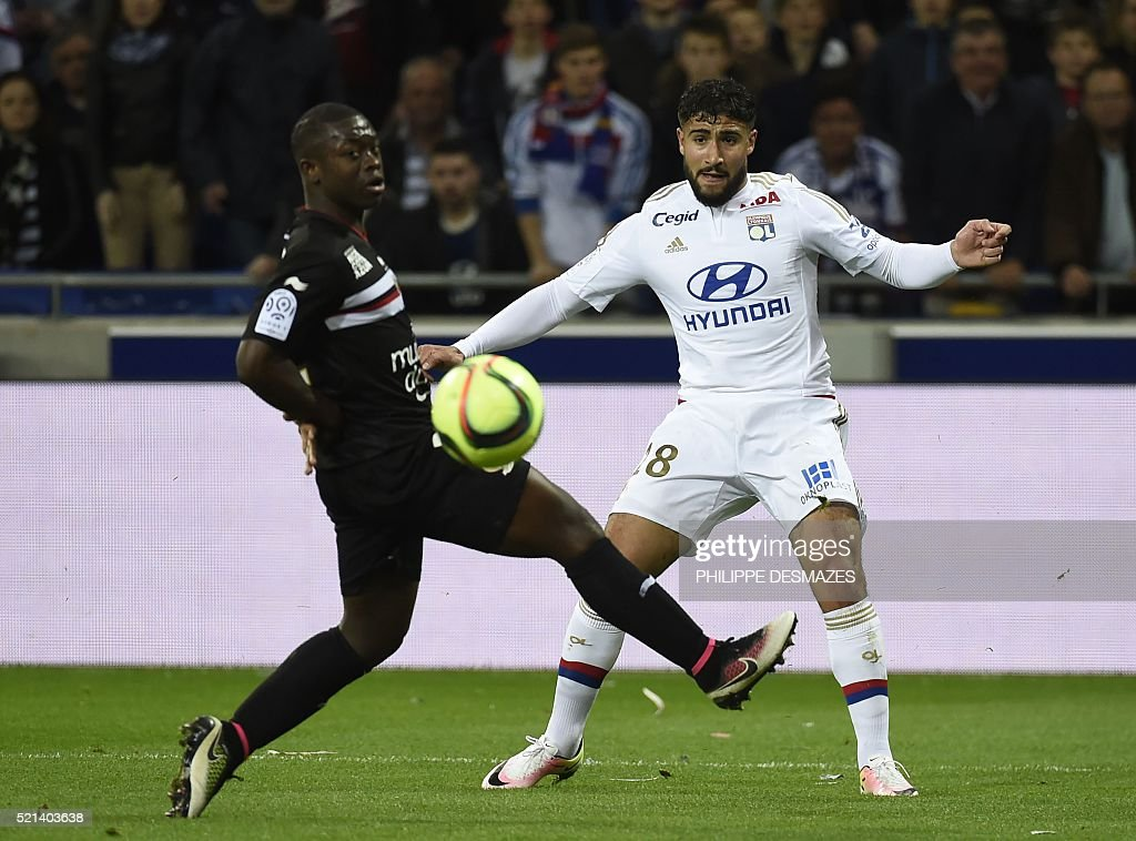 Lyon's French midfielder Nabil Fekir (R) vies with Nice's French midfielder Nampalys Mendy (L) during the French L1 football match Olympique Lyonnais and OGC Nice on April 15, 2016, at the New Stadium in Decines-Charpieu near Lyon, southeastern France.