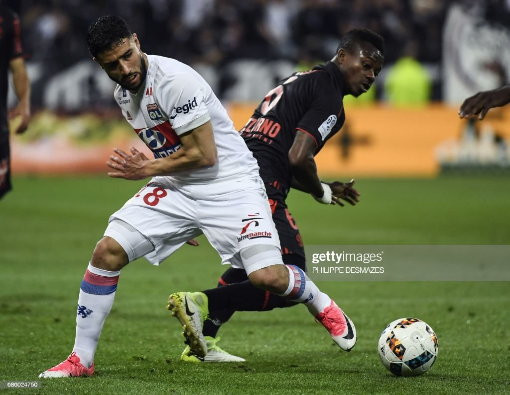 Lyon's French midfielder Nabil Fekir (L) vies with Nice's Ivorian midfielder Jean Michael Seri (R) during the French L1 football match between Lyon (OL) and Nice (OGCN) on May 20, 2017, at the Parc Olympique Lyonnais stadium in Decines-Charpieu near Lyon, central-eastern France. /