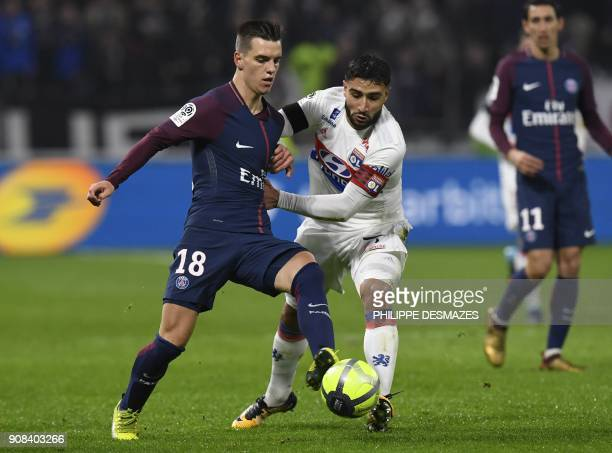 Lyon's French midfielder Nabil Fekir vies with Paris SaintGermain's Argentinian midfielder Giovani Lo Celso during the French L1 football match...