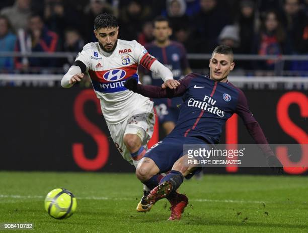Lyon's French midfielder Nabil Fekir vies with Paris SaintGermain's Italian midfielder Marco Verratti during the French L1 football match between...