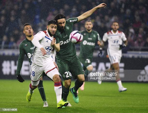 Lyon's French midfielder Nabil Fekir vies with SaintEtienne's Serbian defender Neven Subotic during the French L1 football match between Lyon and...