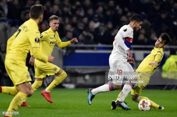 Lyon's French midfielder Nabil Fekir vies with Villarreal's Spanish midfielder Manu Trigueros during the UEFA Europa League football match between...