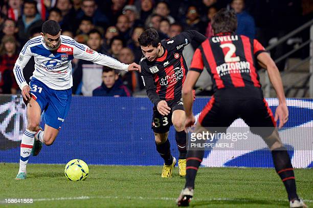 Lyon's French midfielder Rachid Ghezzal vies with Nice's French forward Neal Maupay and Nice's Argentinian defender Renato Civelli during the French...
