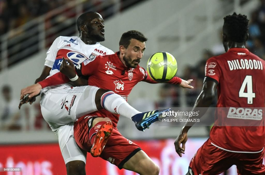 Lyon's French midfielder Tanguy Ndombele (L) vies with Dijon's Senegalese defender Papy Djilobodji (R) and Dijon's French midfielder Romain Amalfitano (C) during the French L1 football match between Dijon FCO and Olympique Lyonnais, on April 20, 2018, at the Gaston Gérard Stadium in Dijon, central France.
