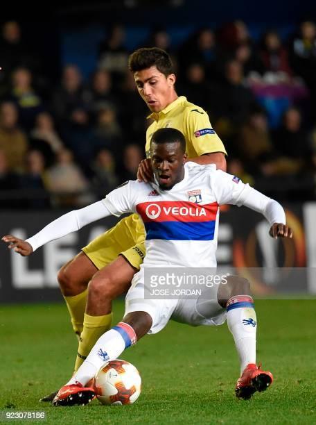 Lyon's French midfielder Tanguy Ndombele vies with Villarreal's Spanish midfielder Rodrigo Hernandez during the Europa League Round of 32 second leg...