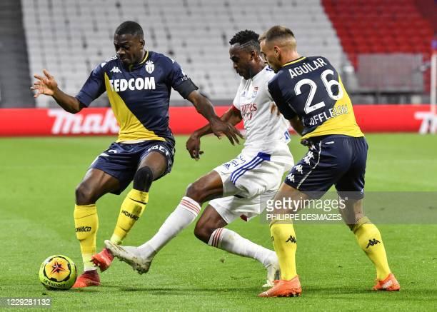 Lyon's French midfielder Tino Kadewere vies with Monaco's French midfielder Youssouf Fofana and Monaco's French defender Ruben Aguilar during the...