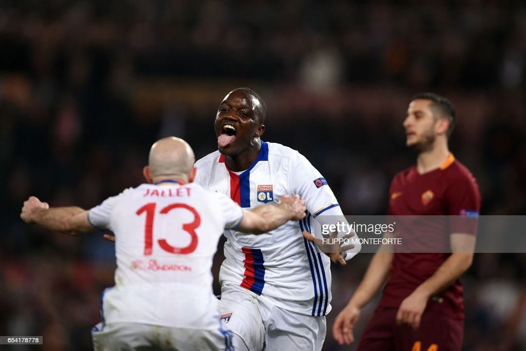 TOPSHOT - Lyon's French Mouctar Diakhaby (C) celebrates with a teammate after scoring a goal during the Europa League Round of 16 return football match between Roma and Lyon on March 16, 2017 at the Olympic Stadium in Rome. /