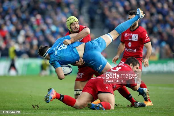 Lyon's French number 8 Virgile Bruni battles with Leinster's Irish number 8 Max Deegan during the European Rugby Champions Cup Pool 1 rugby union...