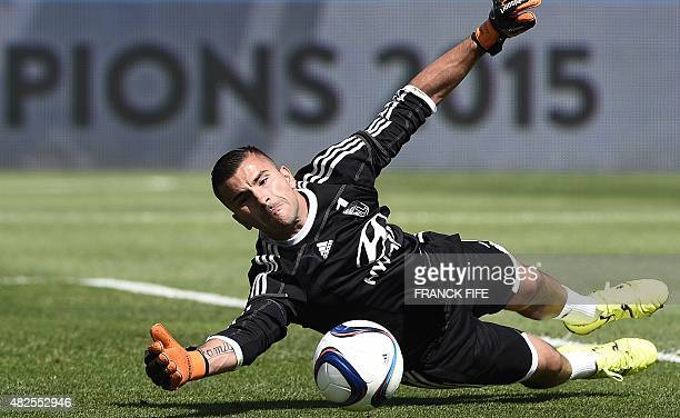 Lyon's French Portuguese goalkeeper Anthony Lopes jumps for the ball during a training session at Saputo stadium in Montreal on July 31 2015 on the...