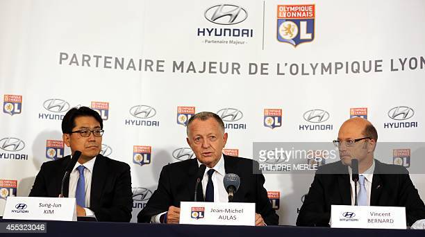 Lyon's French president JeanMichel Aulas presents the club's new sponsor Hyundai with two representatives Kim SungJun and Vincent Bernard ahead of...