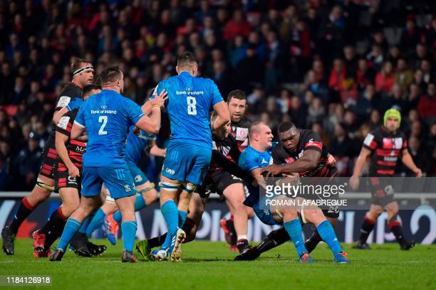 Lyon's French prop Demba Bamba vies with Leinster's Irish flanker Rhys Ruddock during the European Champions Cup rugby union match between Lyon and...