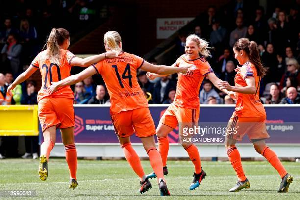 Lyon's French striker Eugenie Le Sommer celebrates with teammates after scoring the opening goal of the UEFA Women's Champions League semifinal 2nd...