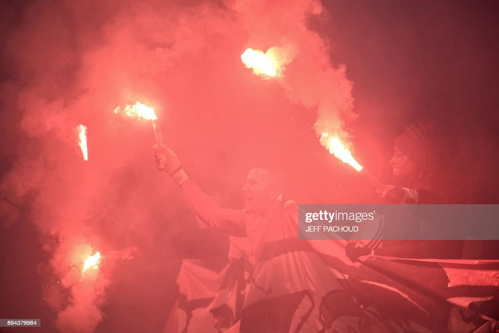 Lyon's French-Portuguese defender Anthony Lopes (C) celebrates with supporters from supporters club 'Bad Gones' to celebrate their 30th anniversary at the end of the French L1 football match Olympique Lyonnais (OL) vs Marseille (OM) on December 17, 2017, at the Parc Olympique Lyonnais stadium in Decines-Charpieu, central-eastern France. /