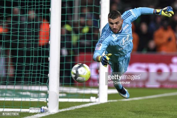 Lyon's FrenchPortuguese defender Anthony Lopes tries to stop the ball during the L1 football match AS SaintEtienne vs Olympique Lyonnais on November...