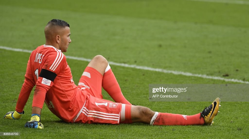 Lyon's French-Portuguese goalkeeper Anthony Lopes stands sit on the pitch conceding a third goal during the L1 football match Olympique Lyonnais (OL) vs FC Girondins de Bordeaux (FCGB), on August 19, 2017 at the Groupama stadium in Décines-Charpieu near Lyon, southeastern France. /